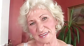 Black granny tenderly fingers her pussy