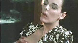 Retro blonde pornstar in action