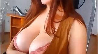 Busty redhead deepthroats hard penis in the car