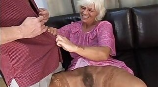 Mature granny in absolute sex with her young man on sofa