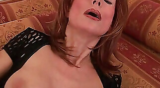 redhead with a nice rack is doing her loving with a toy