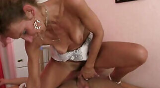 Amazing bimbo gives skillful blowjob to a hard meaty cock before riding