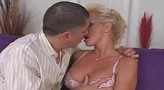 Brunette in lingerie sucking cock on a young guy